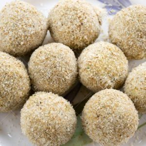 chicken meatballs breaded and ready to be fried
